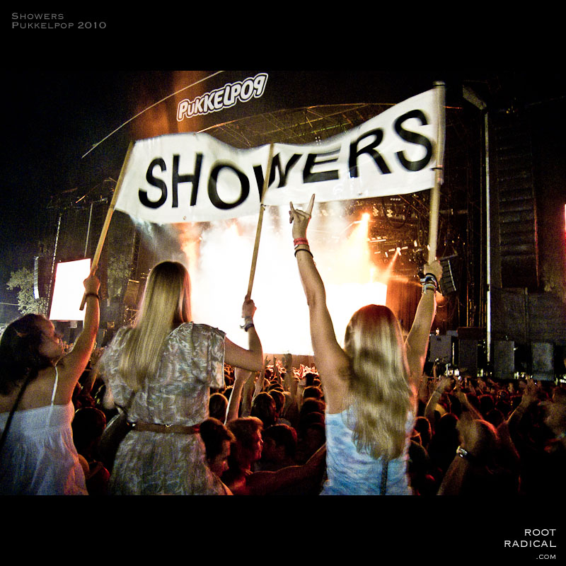 Girls carrying around a big showers sing in the crowd of Pukkelpop 2010
