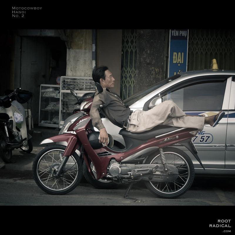 Man sleeping on his motorbike.