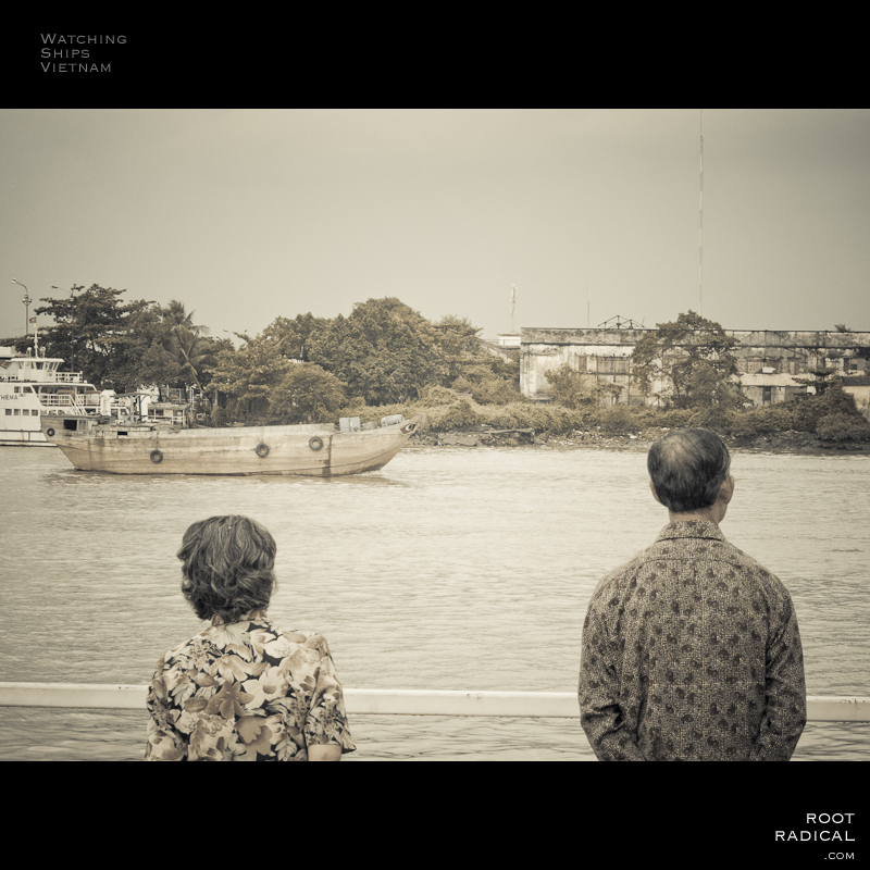 Classic photo: Two asians watching ships.